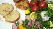 Man Assembles Salami Croissant Sandwich Stock Footage