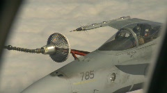 military, F18 Hornet fighter jet refuelling in flight - stock footage