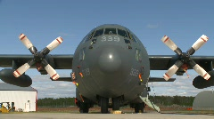 Military, C130 Hercules transport plane on tarmac, head on tight on cockpit Stock Footage