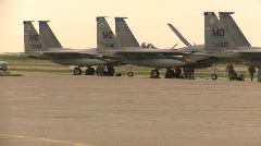 Military, line of F15 Eagle fighter jets with ground crew running Stock Footage