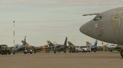 Military, Alphajet fighter jet with AWACS to right foreground Stock Footage