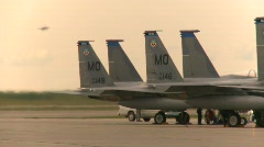 Military, F15 Eagle fighter jet, jet landing in bg, truck passing in fg Stock Footage