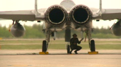 Military, F15 Eagle fighter jet, flaps and engine, Alphajets in bg Stock Footage