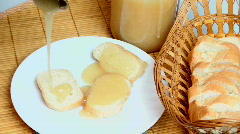 Honey Poured On Bread Stock Footage