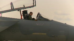 Military, F15 Eagle fighter jet, pilot putting on helmet Stock Footage