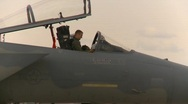 Stock Video Footage of military, F15 Eagle fighter jet, pilot putting on helmet