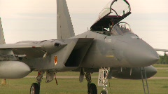 Military, F15 Eagle fighter jet on apron, open cockpit Stock Footage