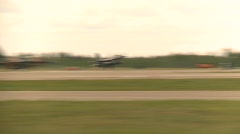 Military, F16 Falcon fighter jet takeoff, #15 follow shot out of frame Stock Footage