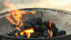 Stock Video Footage of Flames of Fire in a Pile of BBQ Charcoals