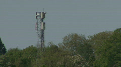 Mobile phone mast through heathaze Stock Footage
