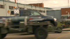 Military, bombing up,  bombs on trailer at airbase being moved Stock Footage