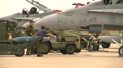 Military, bombing up F18 Hornet fighter jet Stock Footage
