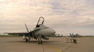 Military, line of F18 Hornet fighter jets on apron Stock Footage