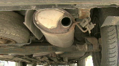 Car with rusty exhaust starts Stock Footage