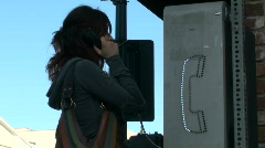 Woman on pay phone - HD  Stock Footage