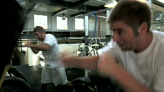 Young boxer punching bag Stock Footage