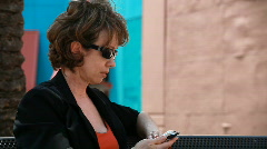 woman sitting at bench calling - stock footage