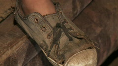 Child In Slums (Shoe's) Stock Footage