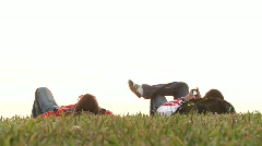 People lying on grass Stock Footage