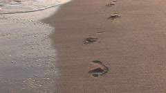 Vanishing footprints on the beach - stock footage