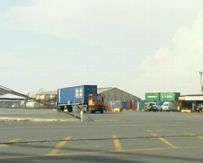 Truck Transporting Container In The Port Stock Footage