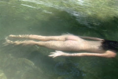 Nude woman swimming - stock footage