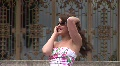 HD720p Young sexy brunette woman talking on cell phone outdoor in the garden Footage