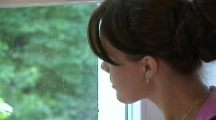 HD1080i Young brunette woman on window - stock footage