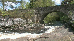 Stone Bridge Over Highland River In  Scotland Stock Footage
