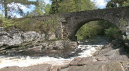 Stock Video Footage of Stone Bridge Over Highland River In  Scotland