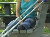 Woman with a Cell Phone on a Park Bench (close-up) Stock Footage
