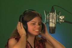 Woman Talking into a Studio Microphone Stock Footage