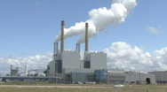 Powerplant with smoking chimneys Stock Footage