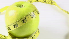 Apple with Tape Measure Rotates Stock Footage