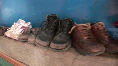 Shoes Of poor child Stock Footage