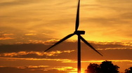 Stock Video Footage of Wind Turbine at sunrise