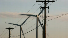 Wind Turbines behind electrical lines Stock Footage