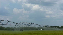 Irrigation farm equipment watering a field Stock Footage