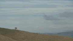 hikers on distant hill zoom out - stock footage
