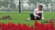 Chinese garden worker Stock Footage