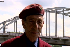 Parachute regiment veteran looking at the Arnhem bridge Stock Footage