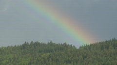 Weather, rainbow over mountain forest Stock Footage