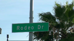 Rodeo Drive sign against blue sky - HD  Stock Footage