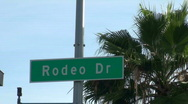 Stock Video Footage of Rodeo Drive sign against blue sky - HD