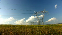 Electricity pylons and moving clouds - time-lapse - stock footage