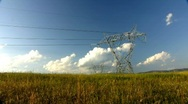 Stock Video Footage of Electricity pylons and moving clouds - time-lapse