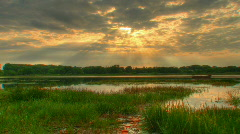 Sunset beams over water hdr time lapse Stock Footage