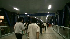 China Hong Kong elevated walkway commuters rush hour traffic Asia Stock Footage
