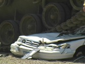 Stock Video Footage of Army Tank crushing Car w/ Sound #2