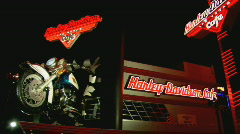 Stock Video Footage of HarleyDavidsonCafe WSlowangle